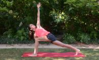 Sending your gaze and shoulders forward, step one foot up from downward-facing dog so it is between your hands at the top of your mat. Press your opposite hand firmly into your mat while you stretch your other hand towards the sky. Send your gaze up to your top hand. While in the pose keep reaching through your back heel to keep that leg engaged. Think of sending your back hip slightly forward and your front hip slightly back to line up your hips.