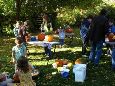 backyard, people carving pumpkins