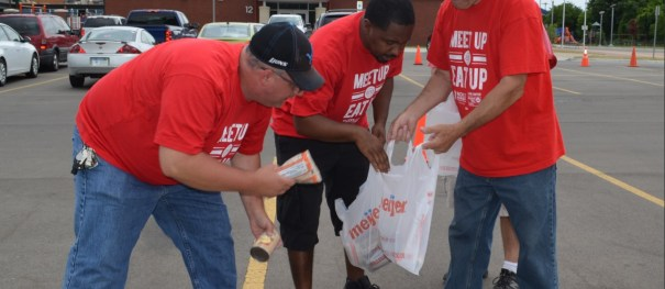 Members of CWA Local 4009 sort food during a Meet Up and Eat Up block party.