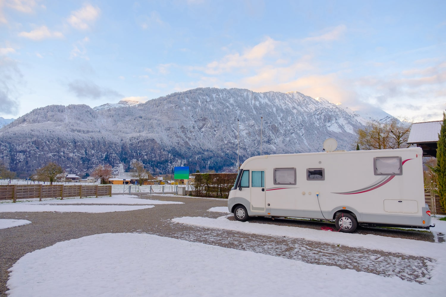 Motorhome car parking in camping in snow falling day.