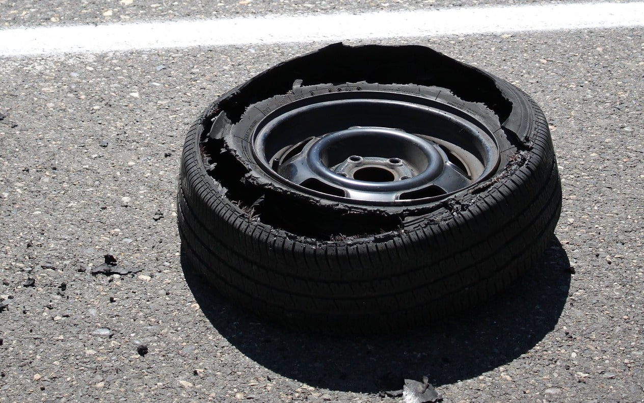 tire blowout on the side of the road