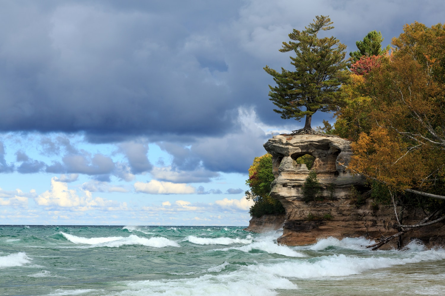 Chapel Rock is battered by crashing waves from Lake Superior at Pictured Rocks National Lakeshore in the Upper Peninsula of Michigan (Chapel Rock is battered by crashing waves from Lake Superior at Pictured Rocks National Lakeshore in the Upper Penins