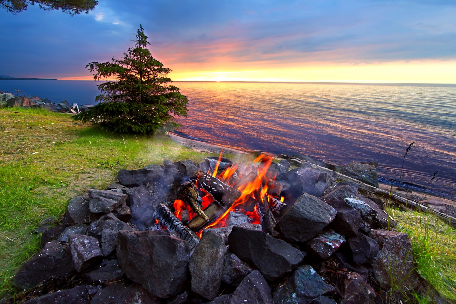 Sunset fire along the beautiful beach of Lake Superior in northern Michigan.