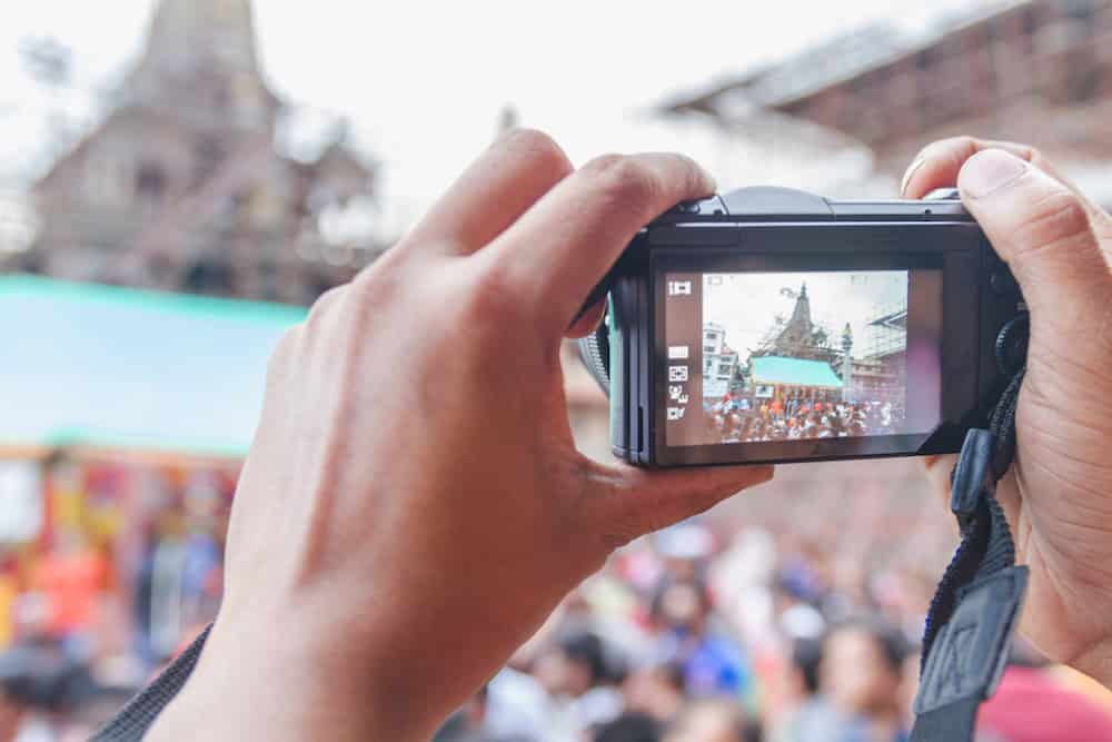 Unknown People Taking Photos with Digital Camera at the Temple in Kathmandu Nepal.