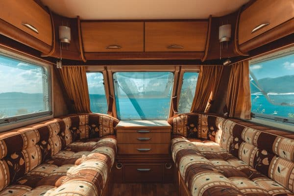 Caravan trailer with sea view, view from the inside, point of view shot. Road adventure