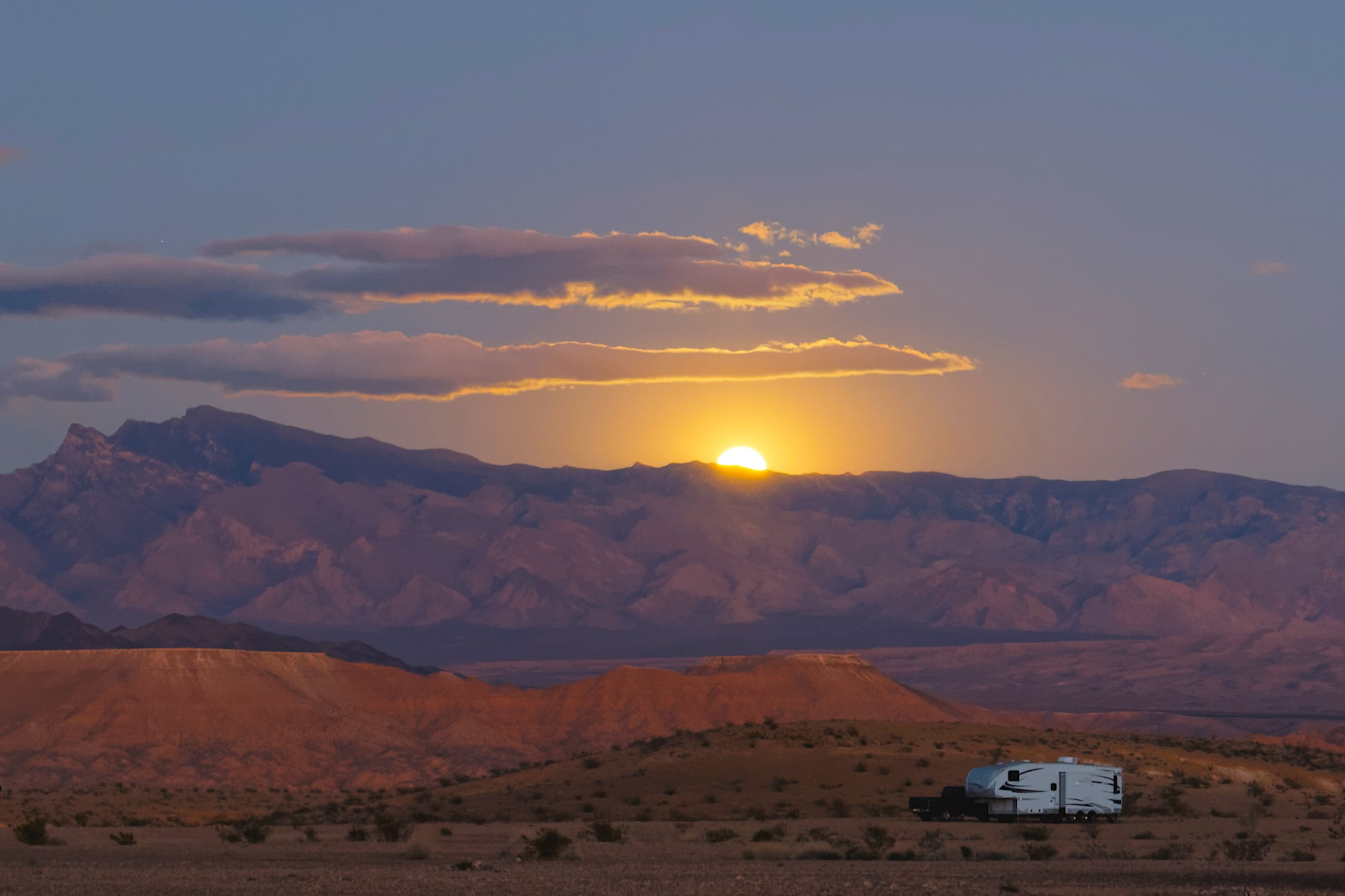 lone rv in desert sunset