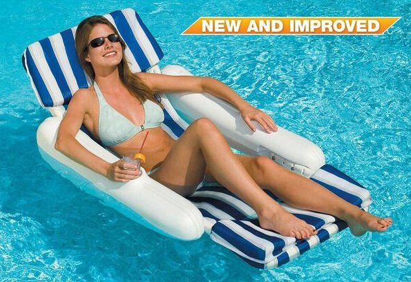 a woman relaxing in a pool lounger