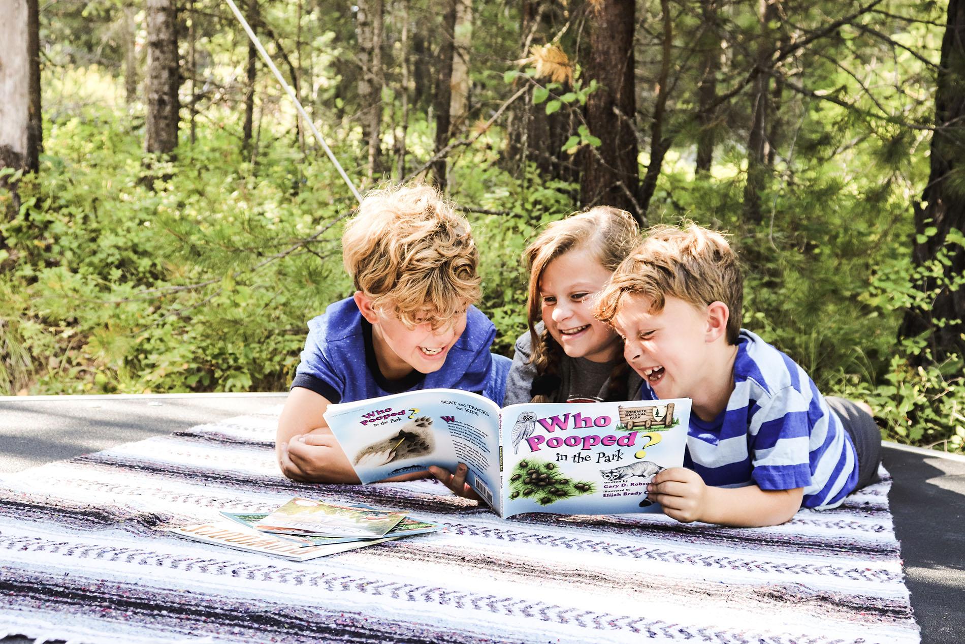 kids laughing at educational book.