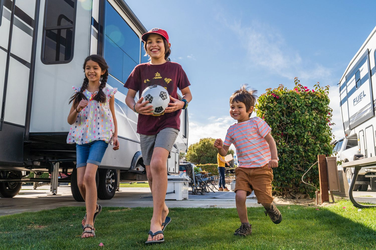 The Harbuck kids play and laugh while traveling by RV.