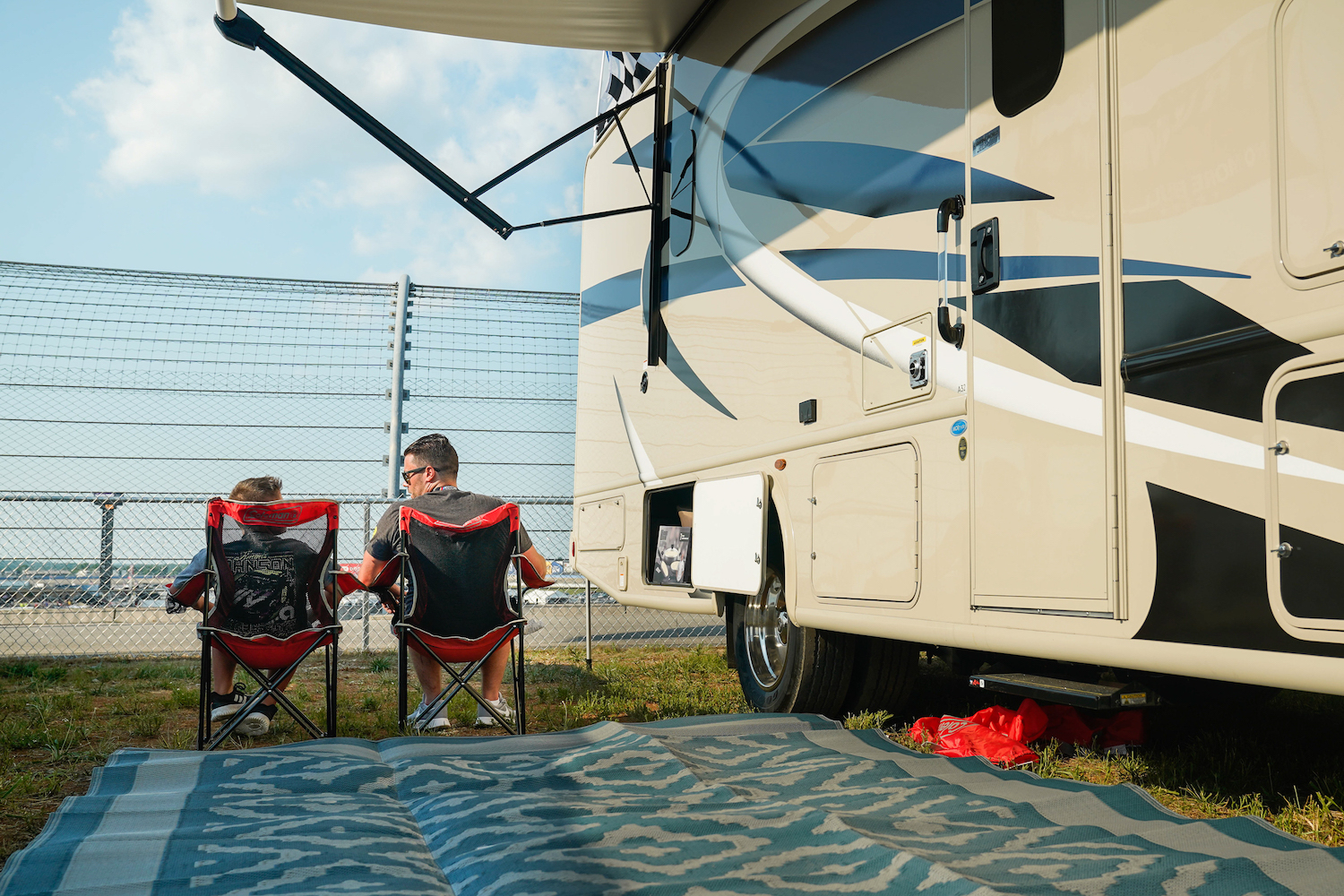 father and son rv camping at NASCAR
