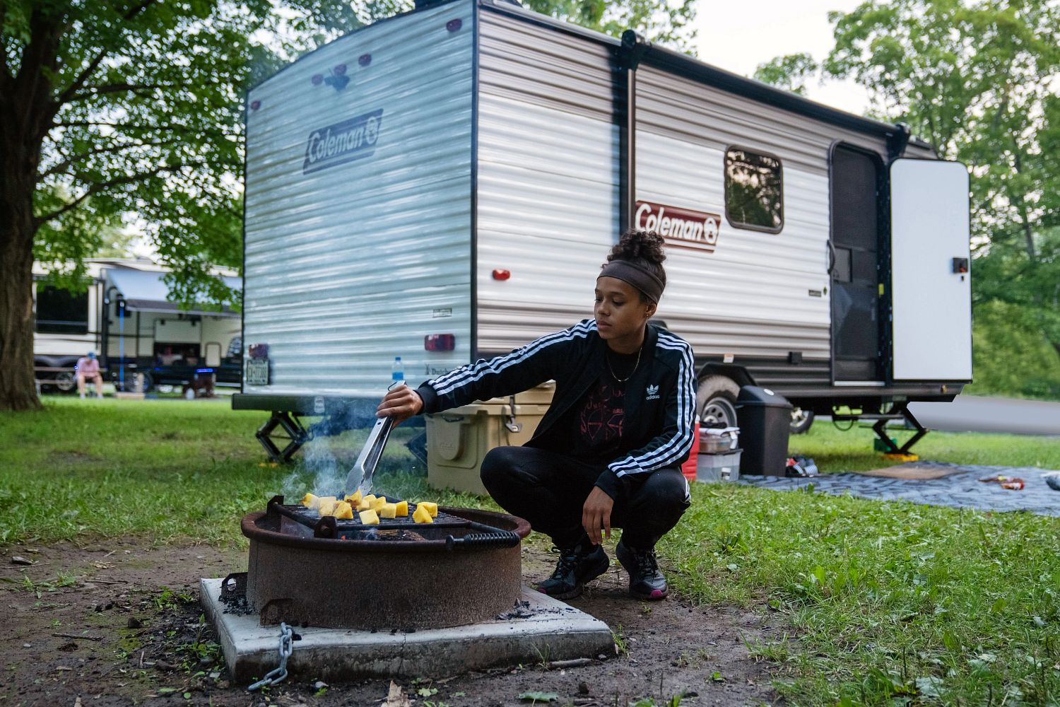 daughter cooking over campfire