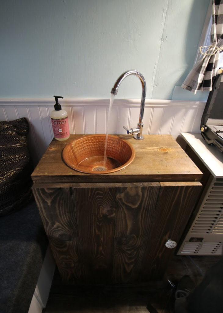 DIY sink inside fish house camper
