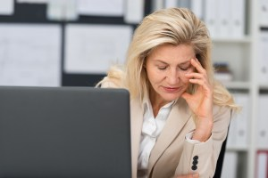 older woman stressed at work
