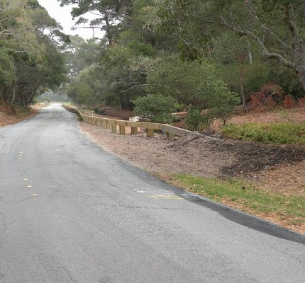 Steel backed guardrail preserves the natural look while provided run off the road protection