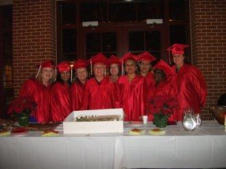 graduates with cake