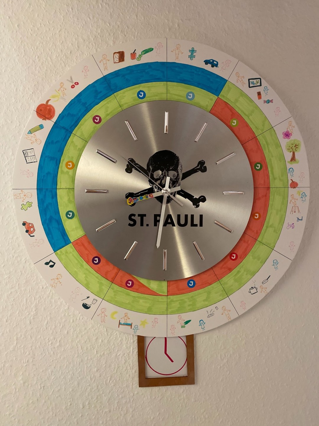 A picture of a clock that was redesigned for the home office with children.