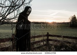 stock-photo-a-ghost-is-coming-at-sunset-328843706