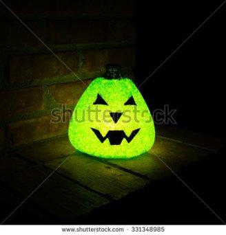 stock-photo-glowing-green-pumpkin-at-night-331348985