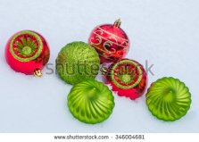 stock-photo-christmas-ornaments-in-snow-346004681