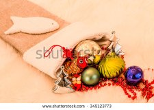 stock-photo-christmas-ornaments-in-stocking-345123773