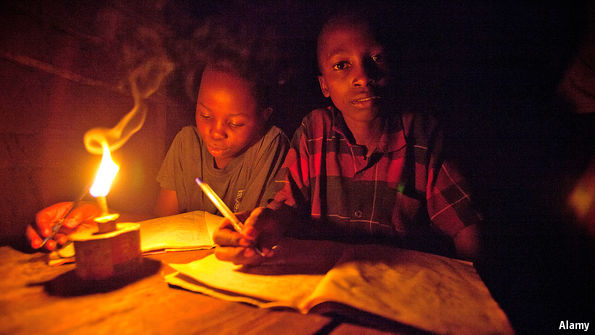 Students studying in the dark due to Zesa Load Shedding