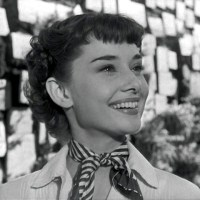Audrey Hepburn smiles!