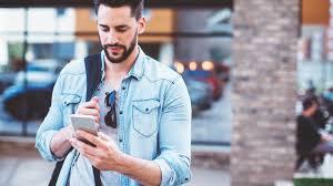 man walking and texting