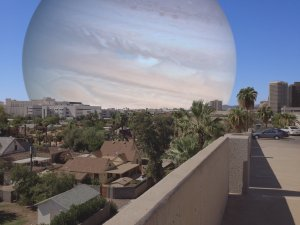 The cover of View from Amalthea. Jupiter rises over the horizon of Phoenix, Arizona.