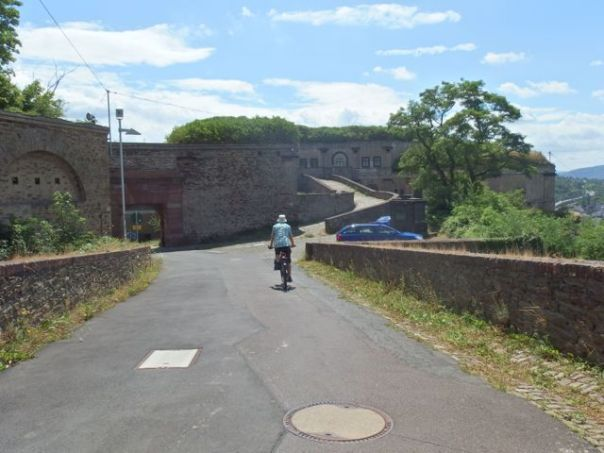 Still cycling downhill beside Fortress walls and gates.