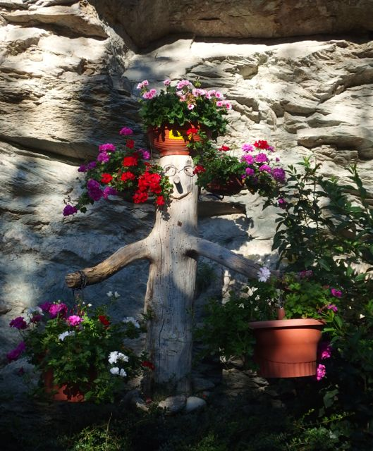 This cute statue welcomes visitors to a small church at a top of a very steep hill.