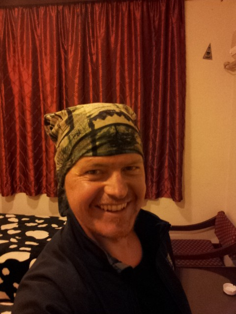 After cycling 90 from Tehran to Qom - Soaking wet and filthy from the rain and lorries.