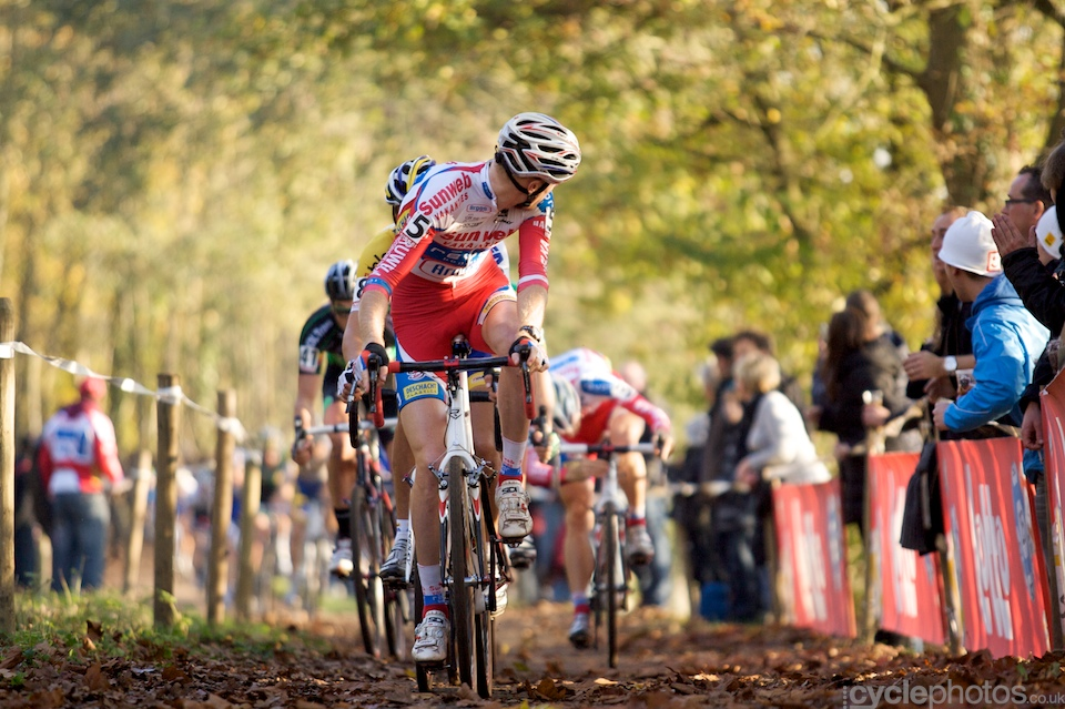 I wasn't sure to include this one or not but I can't help to love it. It was taken at Asper-Gavere, stunning colours and I love how Klaas Vantornout turns back to check whether teammate Kevin Pauwels is ok - who adjusts something on his bike in the background.