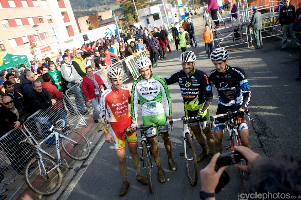 Spanish riders stand for a photo at their home World Cup race.