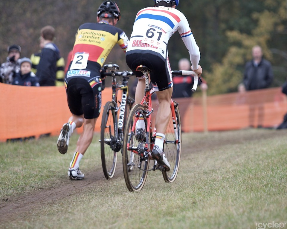 Sven Nys runs with his bike during the first round of the cyclocross men's World Cup in Tabor, Czech Republic.