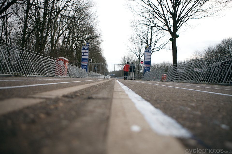The start grid. In the background, Peter van der Abeele, UCI comissaire tests the start lights.