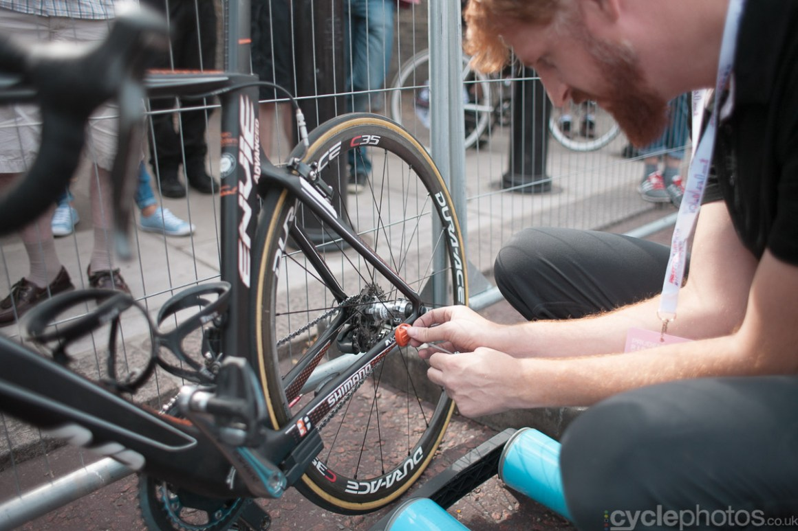 The timing chip is being put on Marianne Vos' bike before the  2014 RideLondon Grand Prix.