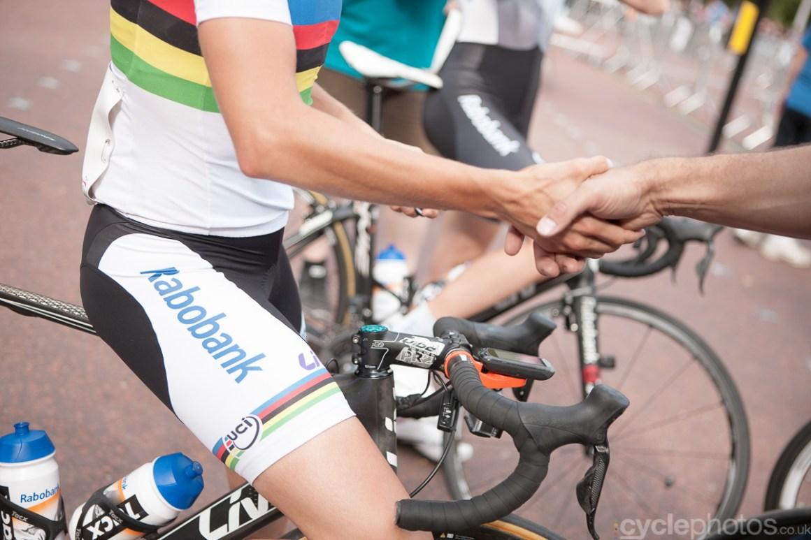 Marianna Vos shakes an organiser's hand before the  2014 RideLondon Grand Prix.