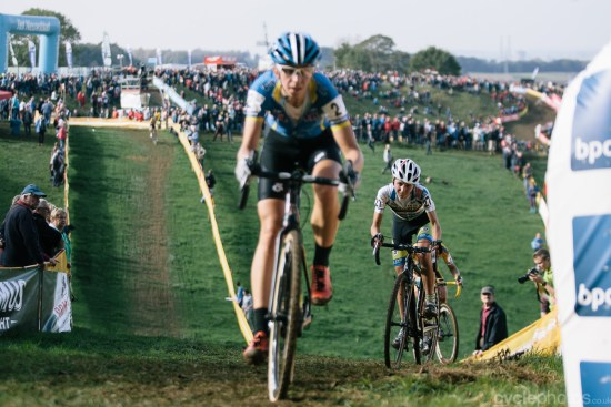 Jollen Verschueren chases Helen Wyman in the penultimate lap of the Bpost Bank Trofee cyclocross race in Ronse. Photo by Balint Hamvas / cyclephotos.co.uk