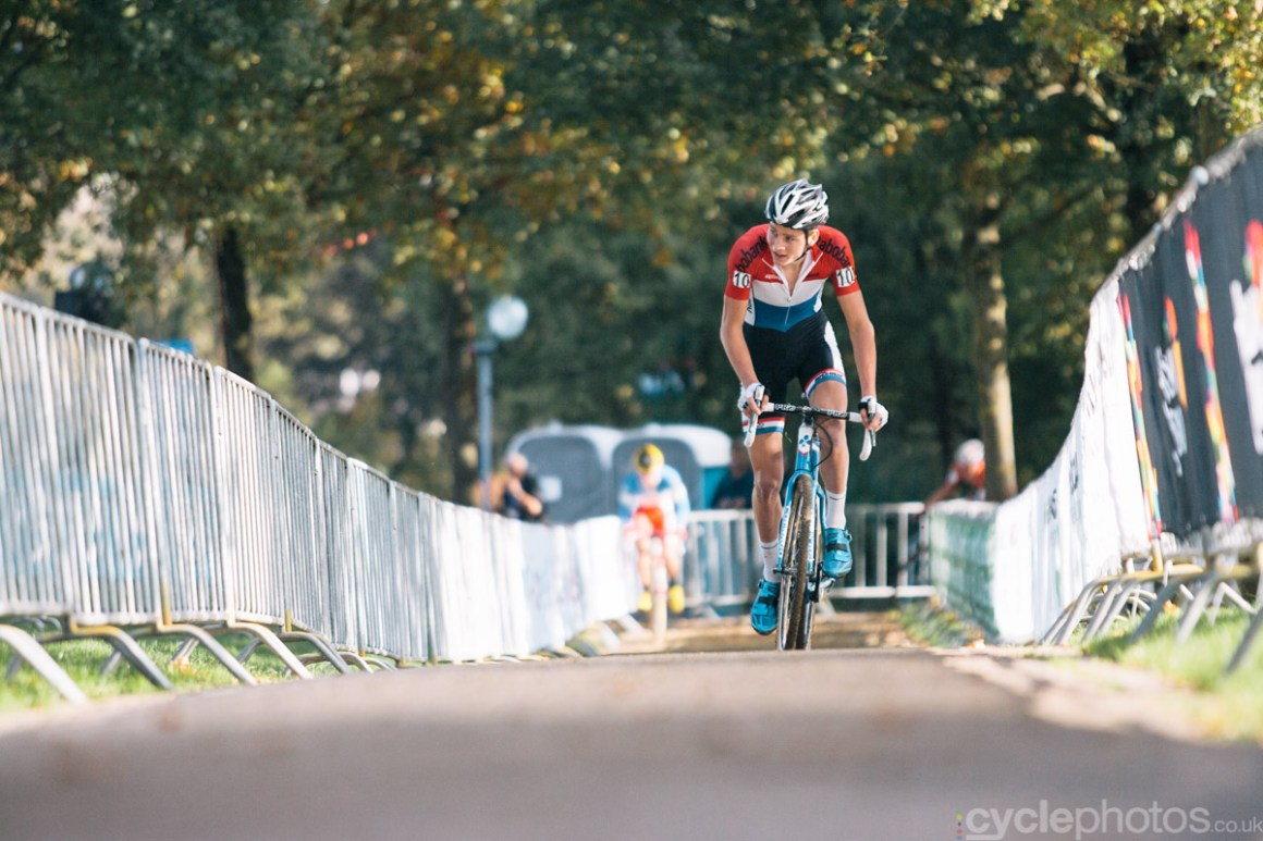 Mathieu van der Poel rides in the first lap of the first cyclocross World Cup race of the 2014/2015 season in Valkenburg.