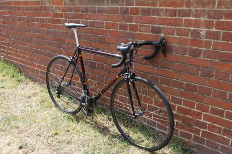 The Malcolm Custom Bicycles' Custom Steel Frame loiters, waiting to show off it's old school ride