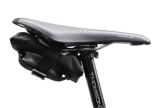 The tool roll comes with a strap to hold a spare inner tube and attach it under your saddle