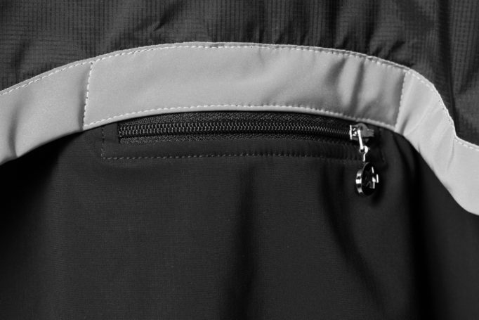 Reflective details on the back and a zipped pocket