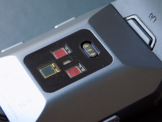 Around the back are three optical sensors and a magnetic charging port