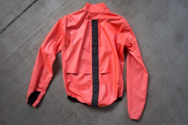back view of the Assos ÉQUIPE RS jacket laying on cement