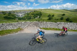 Cycling past Malham Cove