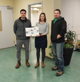 CycleWR Chair Emily Slofstra presents thank you card to trails staff supervisors