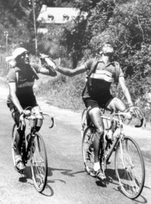 Fausto Coppi and Gino Bartali sharing a bottle at Tour de France 1952