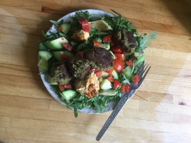 a picture of homemade falafel salad on a wooden work surface