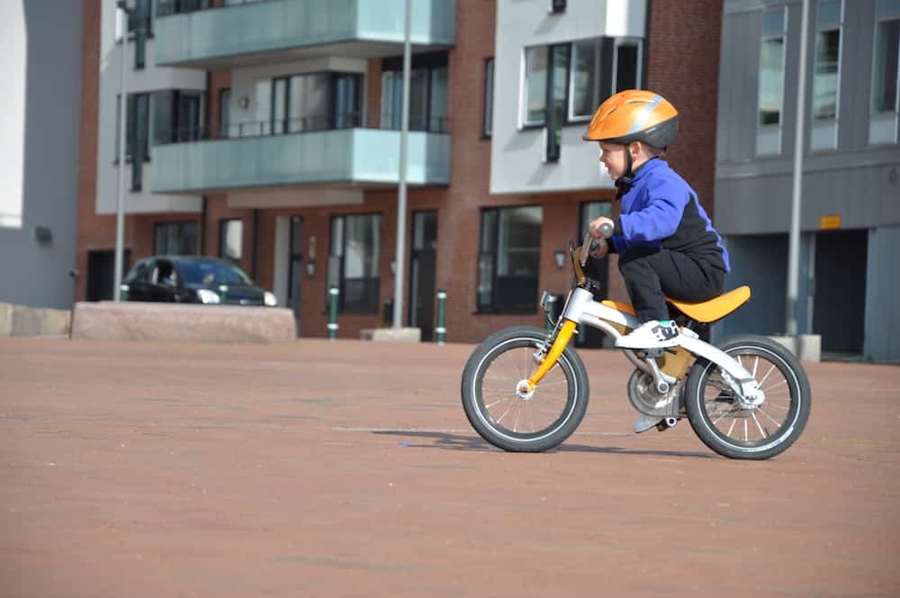 Cycling With Kids - Child Trying New Bike Before Buying