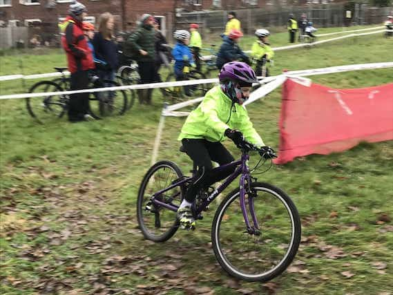 Female rider cornering on cyclocross course